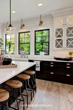 Industrial stools add rustic texture to this otherwise clean-lined black and white Modern Farmhouse kitchen. Industrial stools add rustic texture to this otherwise clean-lined black and white Modern Farmhouse kitchen. Modern Farmhouse Kitchens, Farmhouse Kitchen Decor, Home Decor Kitchen, New Kitchen, Home Kitchens, Kitchen Ideas, Kitchen Photos, Farmhouse Ideas, Rustic Chic Kitchen