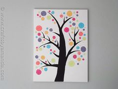 Bright and fun this DIY wall art would look great in a nursery!