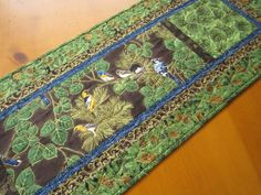 Quilted Table Runner with Birds and Leaves by patchworkmountain.com