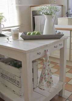 Love the hooks on the side of the table,  and the idea of putting a vase in a tray with fruit