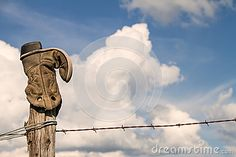 Cowboy boots on fence posts