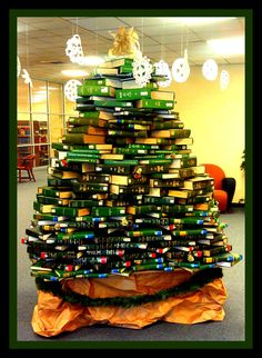 I told you it was coming, and it's here. This is our library Christmas tree. Around 330 books later. I hope no one wants an index between now and finals!