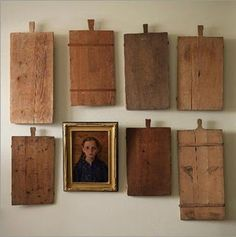 six cutting boards, and a portrait. very odd, indeed....but! I love it. the story of a culinary witch who was a mystery...yet prepared the finest meals anonymously!