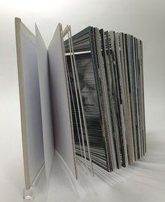 Noriko Ambe —A Book of Minimum, 2013. Altered book. 6 7/16 x 1 3/16 x 5 11/16 inches,  16.3 x 4.4 x 14.4 cm