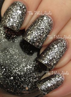 """Nicole by OPI """"Luke Of The Draw"""". Got this for my birthday and I'm trying it out.. Because I """"like black and sparkles""""."""