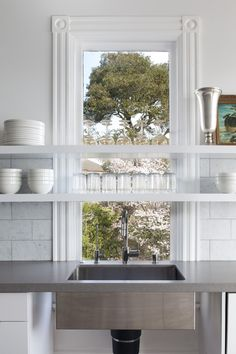 Floating kitchen shelves in front of historic window of Belvedere renovation by Mark Reilly Architecture | Remodelista