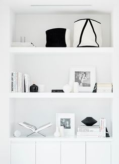 Step Inside Jen Atkin's Modern Home Makeover by Consort Fresh, modern, minimal, cozy all white living room with a high contrast  shelfie moment