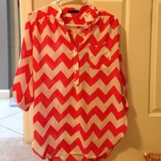 Red and white chevron print top.  Final reduction Red and white chiffon type shirt.  Great with leggings. Has some small slits up the sides.   Has a pocket and 3/4 sleeves in fantastic condition worn once Tops