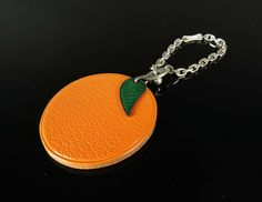 Hermes: Auth Hermes Orange Fruit Leather Sterling Silver Keychain Charm | MALLERIES