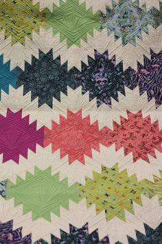 "Quilt Market '13.  Tula Pink's ""Acacia"" collection, via Crimson Tate"