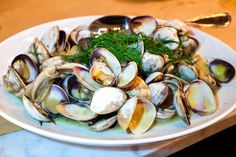 Roasted clams in white wine broth at The Whale Wins in #Seattle