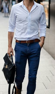 Shop this look on Lookastic:  https://lookastic.com/men/looks/dress-shirt-skinny-jeans-boots-briefcase-belt/13086  — Light Blue Dress Shirt  — Dark Brown Leather Belt  — Navy Skinny Jeans  — Black Leather Briefcase  — Brown Leather Boots