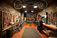 Home Improvement Projects: Reinventing the Garage Floor Bicycle Store, Bike Room, Cycle Shop, Bike Design, Garage Design, Bath And Beyond Coupon, Brompton, Garage Shop, Garage Workshop