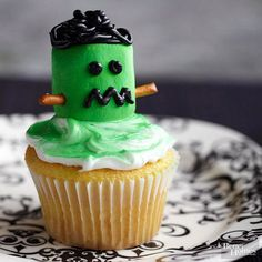 This Frankenstein cupcake is alive with yummy sweetness. With signature neck bolts made from pretzels, this Halloweencupcake is sweet and salty. To make the Frankenstein cupcake, follow these steps: 1. Spray white frosting and a marshmallow with green spray icing. 2. Break a pretzel stick in half; press pieces into each side of the marshmallow to make neck bolts. 3. Press marshmallow onto the cupcake for the head. 4. Pipe on black frosting to make the hair, eyes, and mouth./