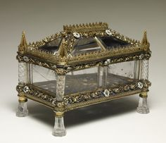 Reliquary Rock Crystal Casket. The workmanship of this casket points to the court of the dukes of Burgundy in the late 1400s. Transparent rock crystal could protect, yet allow the viewing of, a treasured object placed at the center of the emanating rays and secured with clips in the base. The white rose is the emblem of the English royal house of York. Margaret of York (1446-1503), married Charles the Bold, duke of Burgundy, in 1468. She was a patron of religious institutions in the…