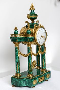 Important Neo-Classical Malachite and Ormolu Mantel Clock, 19th Century | From a unique collection of antique and modern clocks at https://www.1stdibs.com/furniture/more-furniture-collectibles/clocks/