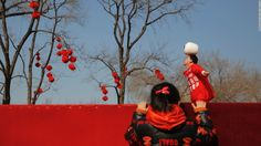 A girl watches an acrobatic performance in Beijing's Longtan Park during Lunar New Year celebrations in February. This is the Year of the Monkey.