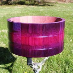 14x7 contoured purpleheart stave snare drum shell I'm working on at the moment. Looks so cool in the sun  #drums #drummer #drumming #drumporn #custom #customdrums ##hhgdrums #stave #stavedrums #woodworking #carpentry #woodworker #smallbusiness #wood #madeintheusa #turning #customsnare #lathe #drumset #drumco #handmade #craftsmanship #craftsman #woodporn #woodturner #woodturning #purple #sun #sunshine by hhg_drums