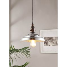 Add a romantic touch to any room in your home with the Vintage Farmhouse pendant, featuring a glinting chrome finish. This effulgent fixture also highlights a single-light design and a chrome shade.