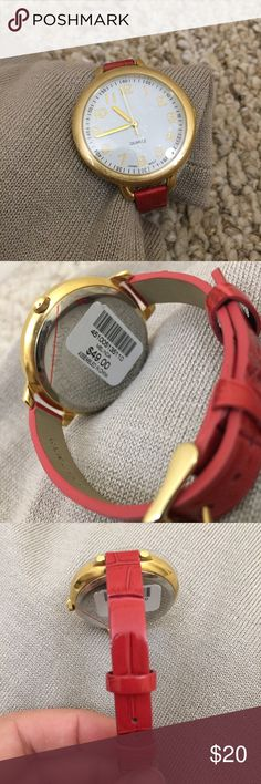 Never worn Chico's leather watch. Never worn Chico's watch. Protective plastic still on face and back. Brushed gold-toned metal details. Red embossed genuine leather band. Perfect for layering with other bracelets! If you would like modeled photos, just ask! Prices are firm. Chico's Accessories Watches