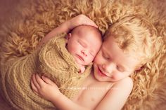 newborn sibling photo