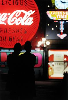 To 'bobbies' in Piccadilly Circus, London, Photo: Saul Leiter.