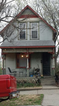 I love the paint colors on this small Victorian house.