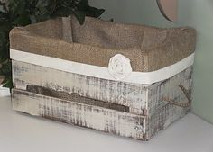 If a bare crate is a little too primitive for you - line it with burlap:
