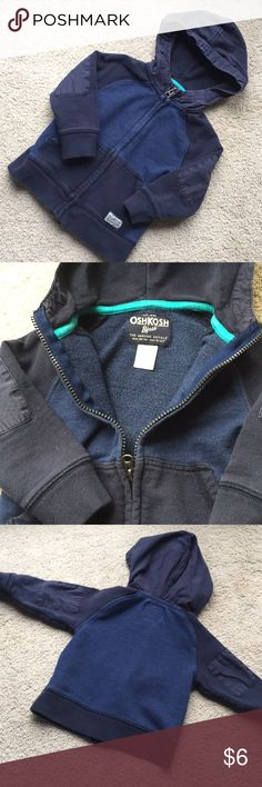Oshkosh Hoodie w/elbow patches Adorable navy blue hoodie from Oshkosh features canvas material on hood and elbow patches, with a navy blue body and contrasting darker blue sleeves, hood and front pocket. Some wash wear but otherwise excellent condition. Check out my closet for more toddler boy clothes- bundle and save! OshKosh B'gosh Shirts & Tops Sweatshirts & Hoodies