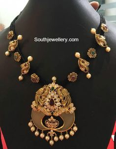 Black Dori Necklace with Peacock Pendant photo