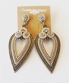 A personal favorite from my Etsy shop https://www.etsy.com/listing/290173029/beautiful-boho-statement-earrings