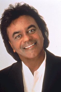 Johnny Mathis...my favorite :)   John Royce Mathis was born on September 30, 1935 in Gilmer, Texas