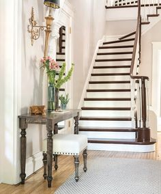You only have one chance to make a first impression. Using key pieces in your entrance hallway - such as a Canadel ottoman and side table, along with complementary tabletop accents - guarantees it will be the best one possible.