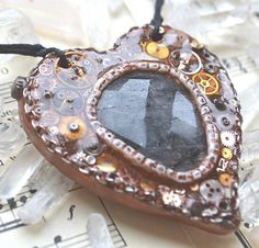 """""""Needles in My Heart""""  This is a beautiful piece of painstakingly handmade work! Behold a metallic copper polymer clay heart pendant painstakingly detailed with vintage watch gears and other pieces. This piece is accented by a mutidimensionally beautiful,"""