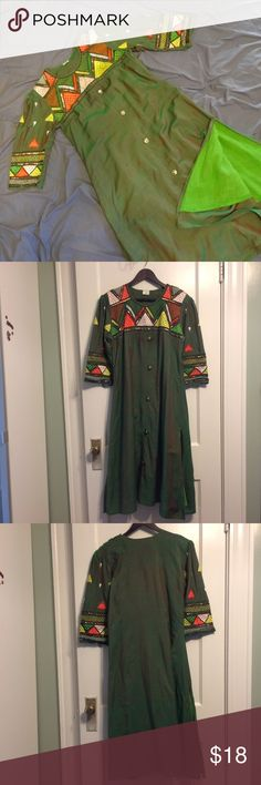 Embroidered dress. Gently worn with some wear. Primarily green dress with a red undertone. Two slits on both sides and decorative buttons down the front. It's a well worn garment so there's some flaws such as loose threads on the embroidery and pilled fabric. Dry cleaning only recommended. Dresses