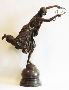 """Claire Jeanne R. Colinet (Belgian, 1880-1950) Title-""""Girl With a Rope"""" Bronze on a marble stand. Signed-""""CL. J. R. Colinet"""""""