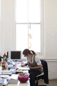 Louise Olsen working in her office at Dinosaur Designs.