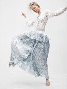 Sasha luss poses in a lace top and micropleated skirt for Vogue Magazine Japan December 2016 issue