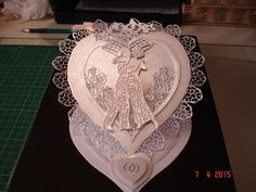 """Made by Jill Watson - """"I used the Tattered Lace Hearts dies and the free butterfly die with the Exclusive Edition magazine, cutting down the butterfly to make the lace edging for the card and for the card face. I also used the Roccoco First Dance Die, all cut from Centura Pearl cardstock with a hint of gold and hint of silver."""" #tatteredlace"""