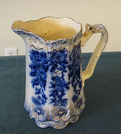 Flow Blue and Gold Gilt Pitcher