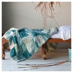 Pretty turquoise bedding to dress up a dorm room.