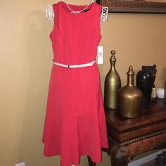 SharaganoRed Dress Very pretty red dress with a little flare on the bottom topped off with a shiny tan belt makes this dress perfect for any occasion Brand new never worn tags still attached Size 10 Dress measures 40 inches long ✨ Sharagano Dresses Midi