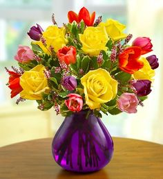 Our Spring Rose and Tulip Bouquet featuring yellow roses, colorful tulips, pink calcynia and variegated pittosporum, gathers springs favorites into one bright and cheery bouquet.