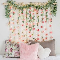 Create a whimsical wall hanging with faux florals for spring! Use it as wall decor, a photo backdrop or wedding decor!