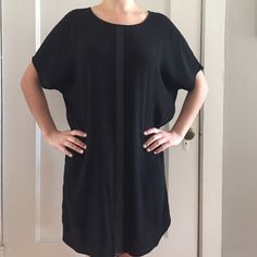 Black Madewell small dress Size small. Summer fun and flirtatious in classic Madewell style. Dress up or dress down. Leather vertical strip down the front. V neck in back. Madewell Dresses