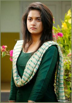 Keerthi Suresh seductive tollywood tempting insane beauty face unseen latest hot sexy images of her body show and navel pics with big cleava.