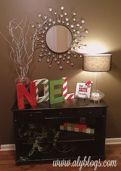 Front entry way ... Hurricane filled with pine cones and spray painted branches ... NOEL letters ... simple!