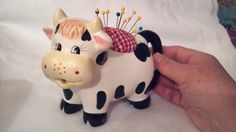 Happy little ceramic cow pin cushion. by DoodleBugWay on Etsy
