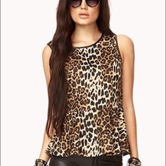 Forever 21 leopard peplum shirt Size Small. Sleeveless peplum leopard pattern shirt. Dress this baby up for a night out! Used lightly, the only imperfection is the front has these tiny loose threads (see last pic). Barely noticeable! Forever 21 Tops Blouses