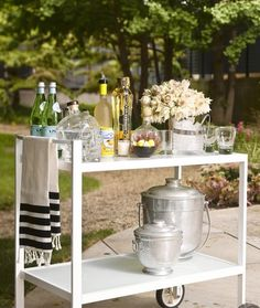 outdoor party ~ I see a use for those vintage ice buckets.